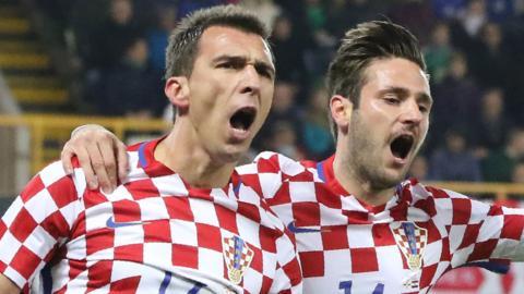 Croatia celebrate after Mario Mandzukic opens the scoring at Windsor Park