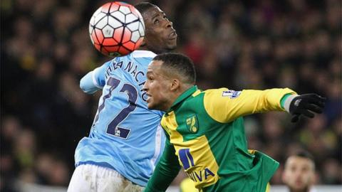Kelechi Iheanacho and Martin Olsson jostle for an aerial ball