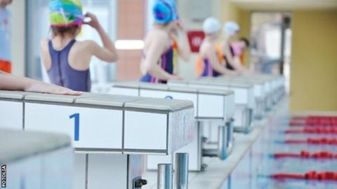 Children prepare for a swimming race