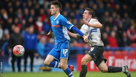 Scott Tanser playing for Rochdale against Bury