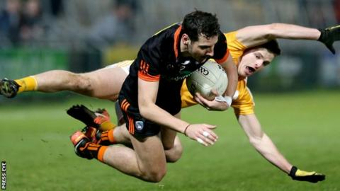 Armagh forward Jamie Clarke and Antrim's Conor Hamill take a tumble at the Athletic Grounds