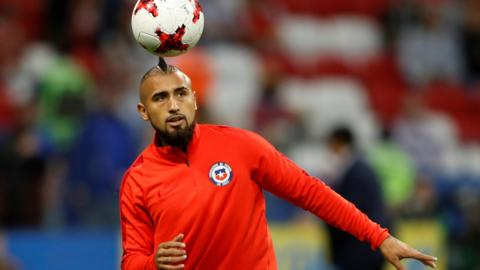 Arturo Vidal warms up