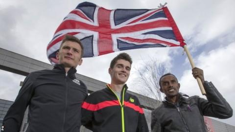 Derek Hawkins, Callum Hawkins and Tsegai Tewelde fly the Union Jack
