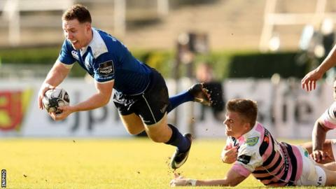 Cardiff's Gareth Anscombe tackles Leinster's Rory O'Loughlin