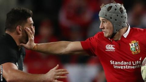 Jonathan Davies hands off Codie Taylor in the first Test