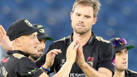 Mathew Pillans (right) is congratulated by Leicestershire team-mates after taking a wicket