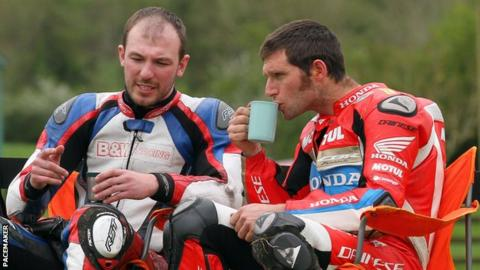Guy Martin sips a cup of tea after crashing out of the opening superbike race at the Tandragee 100