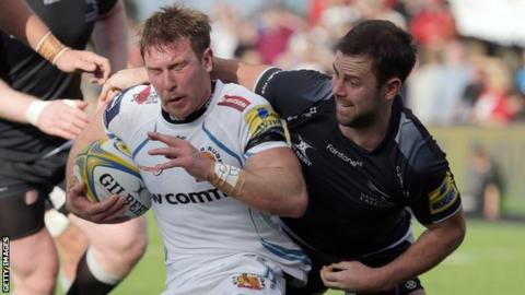 Exeter Chiefs' former Falcons half Will Chudley is tackled by opposite number Michael Young