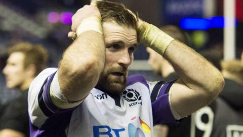 Scotland captain John Barclay looks dejected after defeat by New Zealand