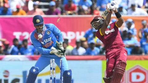 India's MS Dhoni and West Indies' Dwayne Bravo