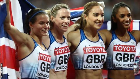 Zoey Clark (far left) and Eilidh Doyle (second from left) celebrate their silver medal with 4x400m relay team-mates Emily Diamond and Laviai Nielsen