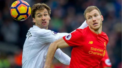 Swansea's Fernando Llorente (L) in action with Liverpool's Ragnar Klavan