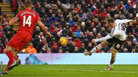 Wayne Rooney scores as Jordan Henderson looks on