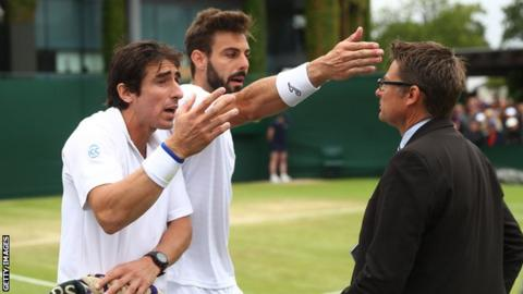Pablo Cuevas (left) and Marcel Granollers argue with the match referee