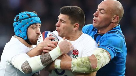 Italy captain Sergio Parisse tackles England's Ben Youngs