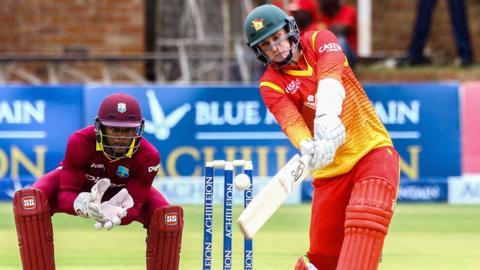 West Indies' Shai Hope and Zimbabwe's Peter Moor