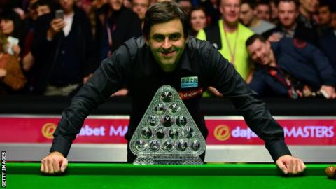 Ronnie O'Sullivan poses with the Masters trophy