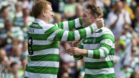 Hibernian manager Neil Lennon greets Kris Commons during Sunday's charity game