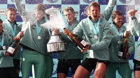 Cambridge celebrate victory in the 2016 men's Boat Race