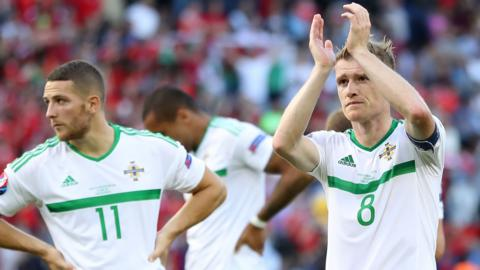 Northern Ireland captain Steven David acknowledges the fans after Saturday's defeat by Wales