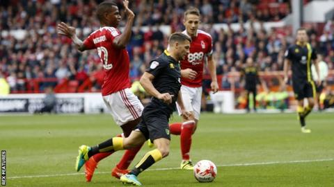 Wes Hoolahan of Norwich is fouled by Nottingham Forest's Nicolao Dumitru and wins a penalty