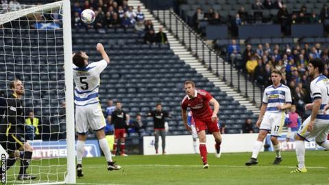 Adam Rooney loops in the winning goal for Aberdeen at Hampden