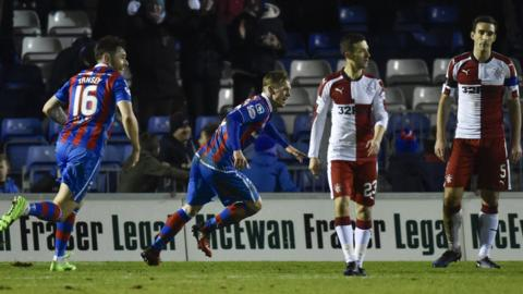 Billy Mckay races away to celebrate after netting the acrobatic winner for Inverness