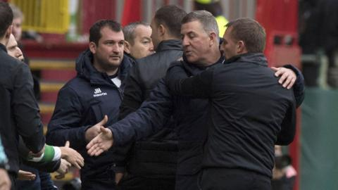 McGhee and Rodgers embraced at full-time