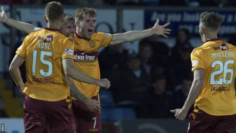 Motherwell's Chris Cadden (centre) celebrates after making it 2-1