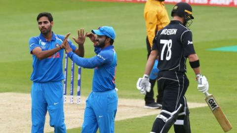 India's Bhuvneshwar Kumar celebrates the wicket of New Zealand's Corey Anderson