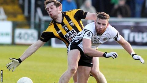 Crossmaglen's Johnny Hanratty challenges Kilcoo's Paul Greenan in the 2013 Ulster Club quarter-final replay