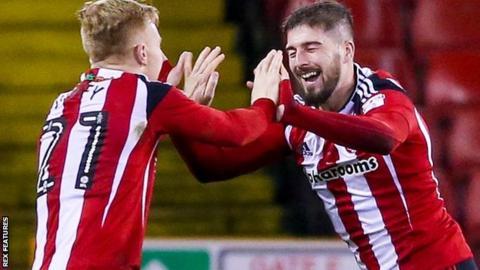 Kieron Freeman celebrates Sheffield United's second goal against Millwall