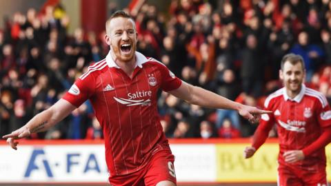 Adam Rooney celebrates his winning goal