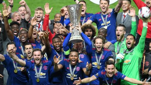 Manchester United with the Europa League trophy