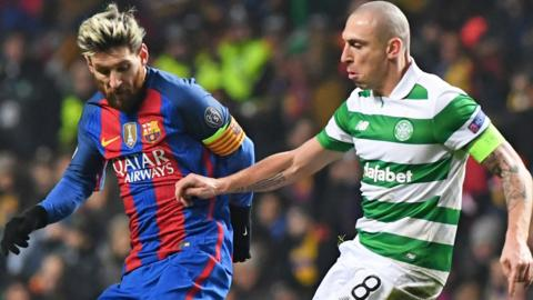 Celtic captain Scott Brown tackles Barcelona's Lionel Messi