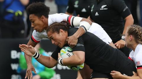 Fiao'o Faamausili of New Zealand is tackled by Kristen Thomas (left) and Deven Owsiany (right) of the United States