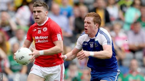 Connor McAliskey attempts to brust away from Kieran Duffy at Croke Park