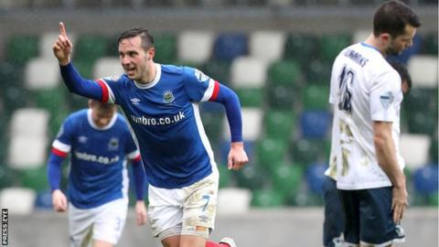 Andrew Waterworth celebrates his 100th goal for Linfield in the Windsor Park win over Ards
