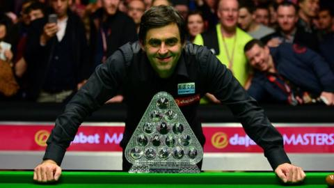 Ronnie O'Sullivan poses with the Masters trophy after winning the 2016 final against Barry Hawkins