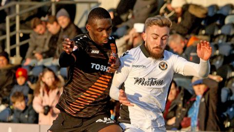Dan Butler (right) on the attack for Newport County against Barnet