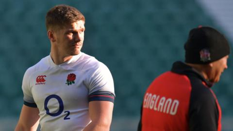 England centre Owen Farrell and head coach Eddie Jones