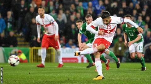 Switzerland's Ricardo Rodriguez scores from the penalty spot against Northern Ireland