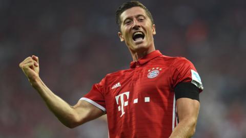 Bayern Munich forward Robert Lewandowski celebrates scoring a hat-trick against Werder Bremen