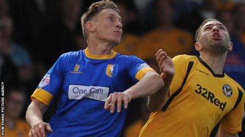 Martin Riley challenges Newport's Robbie Willmott