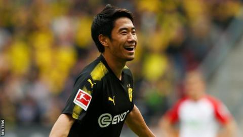 Borussia Dortmund show grit to go with grace in Augsburg win