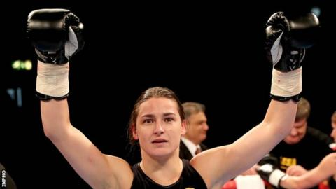 Katie Taylor celebrates after winning her first professional contest on Saturday