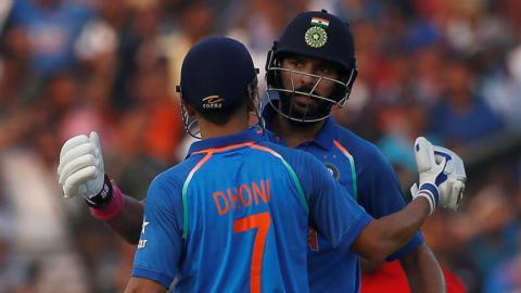 Yuvraj Singh congratulates his teammate