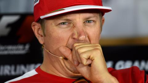 Kimi Raikkonen yawns in a press conference