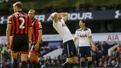 Harry Kane reacts after missing against Bournemouth