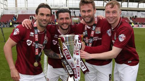 Northampton Town players with the League Two trophy